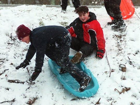 In Neville, Ohio this foursome found the sledding fun