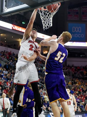 USD's Tyler Flack dunks the ball while Western Illinois's Brandon Gilbeck defends during the Summit League men's basketball championship quarterfinals on Saturday, March 4, 2017 at the Denny Sanford Premier Center.