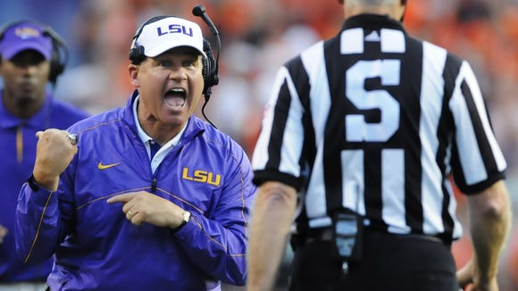 LSU coach Les Miles leads the Tigers into a pivotal SEC game at Alabama.