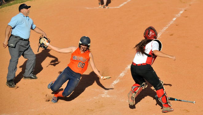 Millville's Caroline Kruger scores ahead of a throw to Vineland catcher Korie Hague in a Thunderbolts' win on April 18. Currently ranked No. 6 in the Mean 15, Millville's been one of the few consistent clubs in South Jersey.
