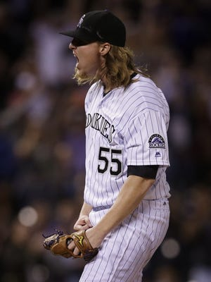 Jon Gray reacts to the last out of his complete-game shutout against the San Diego Padres.