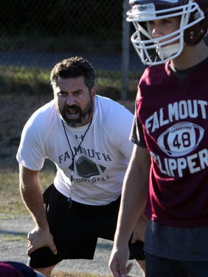 Falmouth High School head coach Derek Almeida directs his football players through preseason drills at Guv Fuller Field in 2016. Almeida, a 1998 graduate of Fairhaven High School, announced over social media that he has accepted a position there as head football coach.