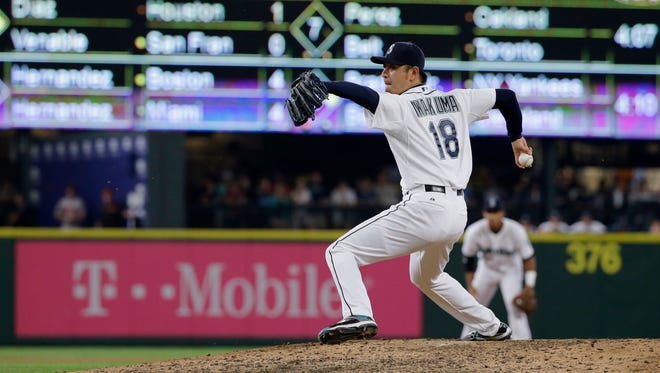 Seattle Mariners starting pitcher Hisashi Iwakuma throws during the eighth inning of a baseball game against the Baltimore Orioles, Wednesday, Aug. 12, 2015, in Seattle.