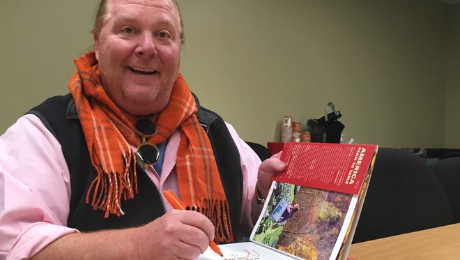 Mario Batali started signing cookbooks for fans even before his appearance Nov. 21 at Market District in Carmel.