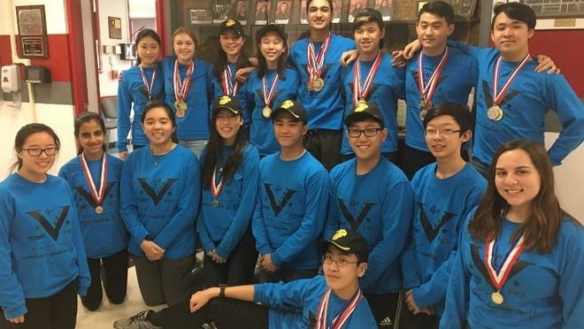 The Parsippany High School Academic Decathlon (AcDec) Team. Back left to right: Ellie Xu, Alice Limanova, Miki Hansen, Katherine Yang, Rohan Khajuria, Will Chen, Adam Ye, Hugh Kwong. Front left to right Annie Zhong, Sejal Murth, Karen Shih, Jessica Ho, Nicholas Lim, Daniel Kuo, Richard Sevilla, Andrew Lie, Alivia Mercuro.