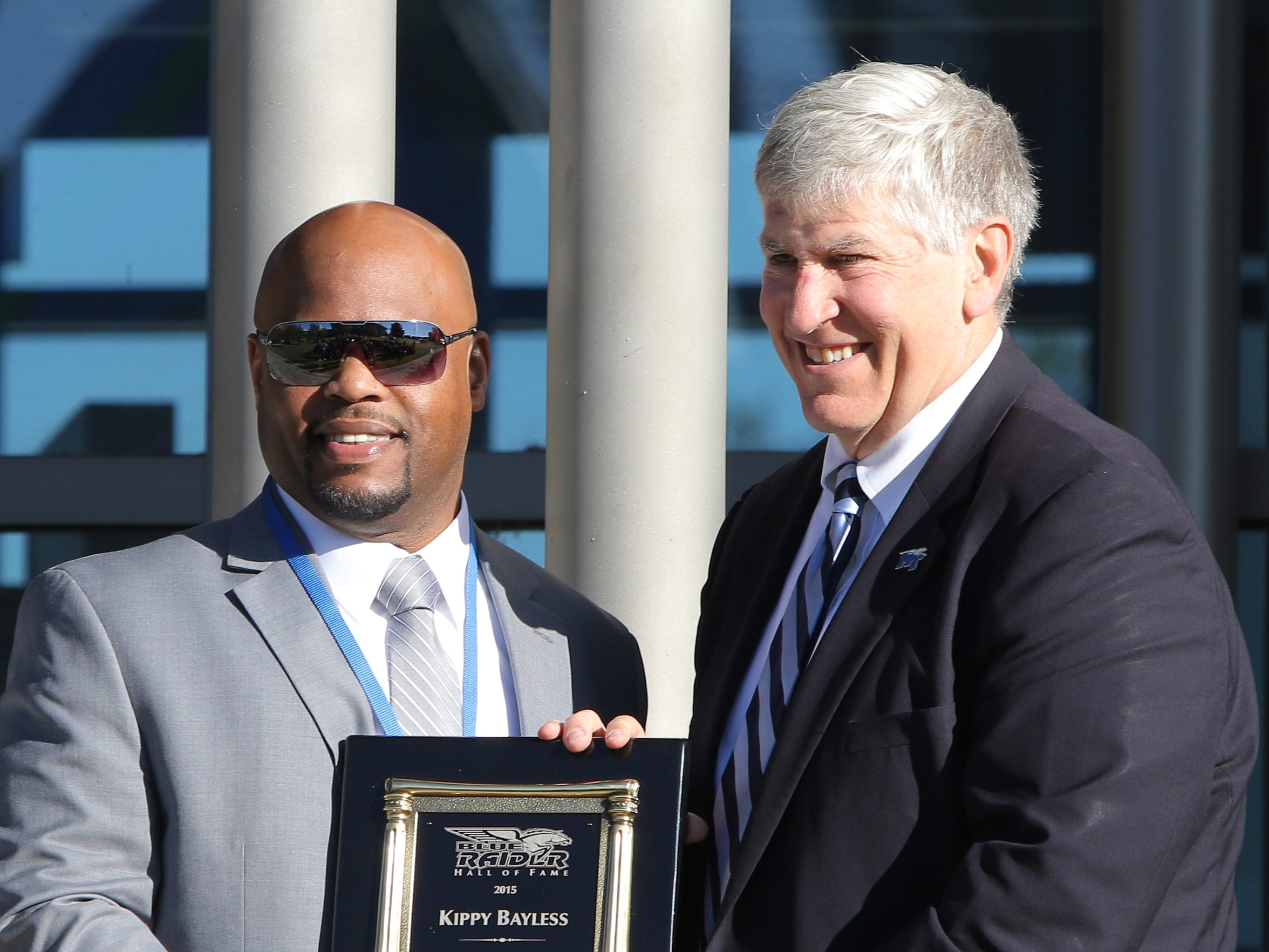 Kippy Bayless stands with Chris Massaro, MTSU director of athletics