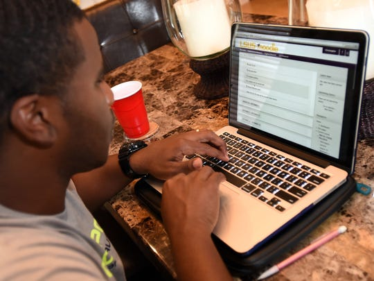 Christopher Mahone works on his Masters in Business Administration form his home in Shreveport through LSUS's online MBA program. The program is ranked fourth in the nation and enrollment is increasing.