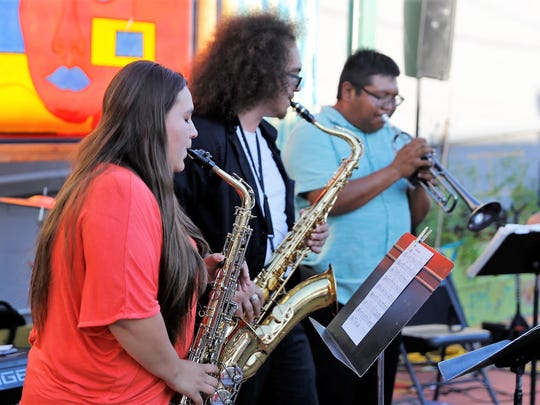 Deja Trujillo Montoya, left, Justin Medine and Delbert Anderson are featured during the weekly jazz jam session on July 11 at the Studio 116 pocket park.