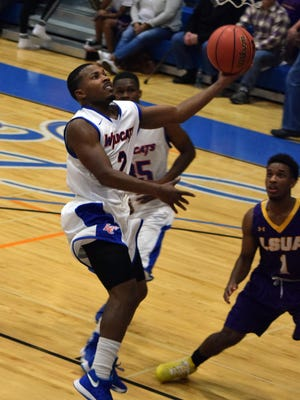 Louisiana College's Kevin Cottonham (2) goes for two against LSUA in the Red River Rivalry held Friday at H.O. West Fieldhouse on the Louisiana College campus.