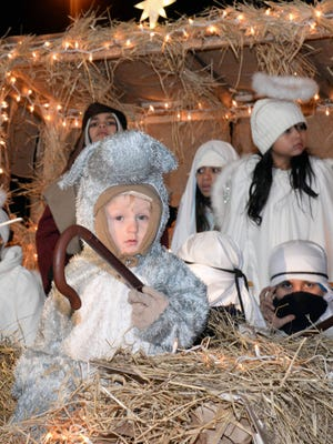 Members of New Beginning Pentacostal Church in Millville are pictured on a manger-themed float during last year's holiday parade in Millville.