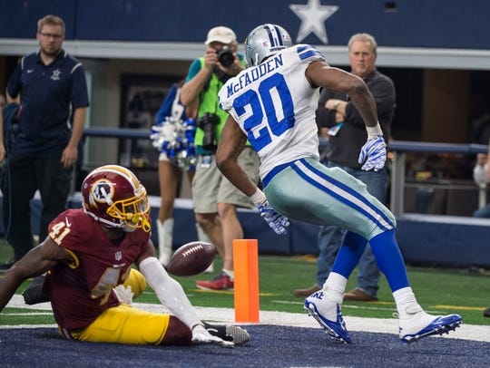 Dallas' Darren McFadden loses this fumble out of the
