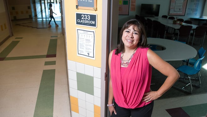 Sonoma Elementary School principal Melissa Galaz is pictured in the hallway of the school on a recent day. Galaz has history of breast and ovarian cancer in her family and opted for  an elective double-mastectomy in 2013. Nearly two years later, her fallopian tubes and ovaries were removed to reduce her chances of developing ovarian cancer.