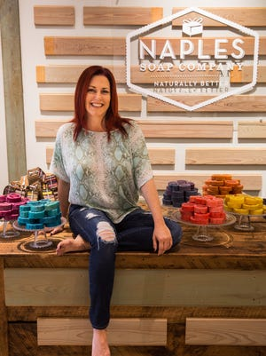 Deanna Renda sits in her Naples Soap Company store at Coconut Point mall in Estero, Florida, on Wednesday, Aug. 31, 2016. Renda, a former nurse, founded the Naples Soap Company in 2009 to make products (ranging from $5 bath bombs to $8.50 bars of soap) that she and her daughter, who both suffered from eczema and psoriasis, could use.