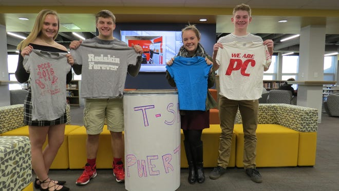 The Port Clinton High School Leadership Council will be collecting T-shirts to be sent to hurricane victims in Puerto Rico.  From left are Marie Gluth, Cooper Stine, Hannah Moore and Max Brenner.