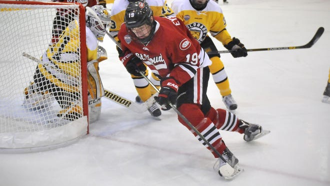 St. Cloud State's Mikey Eyssimont carries the puck past Colorado College goaltender Jacob Nehama last season at the Herb Brooks National Hockey Center. Eyssimont was selected by the Los Angeles Kings in the fifth round of the NHL Entry Draft on Saturday.