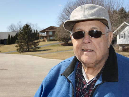 Every street needs a neighbor like George Laukant, an 81-year-old retiree who clears snow, mows lawns, tills gardens and even dog sits for his out-of-pocket expenses.