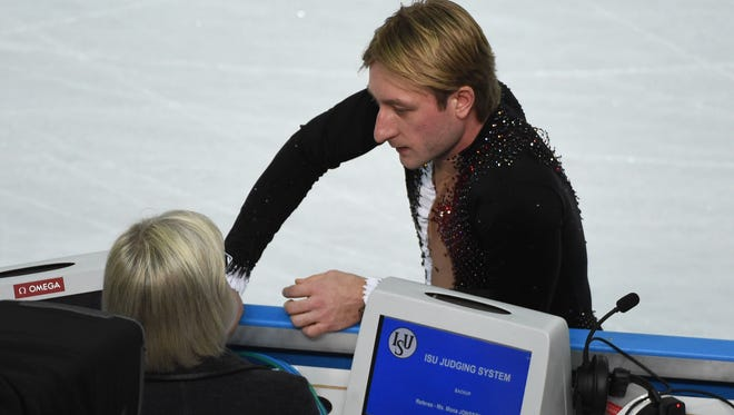Russia's Evgeni Plushenko tells the judges he is pulling out of the men's figure skating competition prior to the short program on Feb. 13 because of a back problem. He announced Saturday he will have surgery.