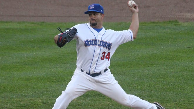 Rockland Boulders' Richard Salazar delivers a pitch during the team's season opener against the Quebec Capitales at Provident Bank Park May 23, 2014.