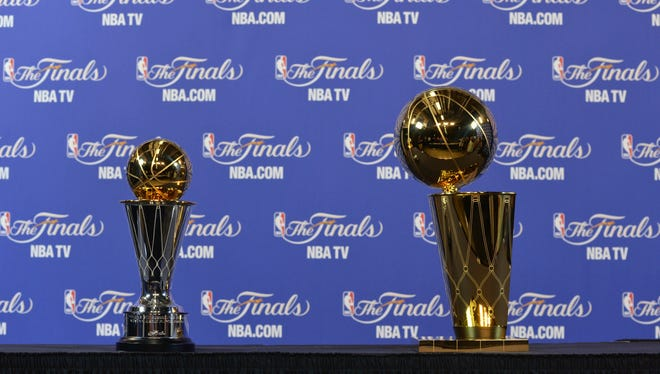 The MVP trophy and the Larry O'Brien  Championship trophy on display for the media prior to game seven in the 2013 NBA Finals between the Miami Heat and the San Antonio Spurs at American Airlines Arena.