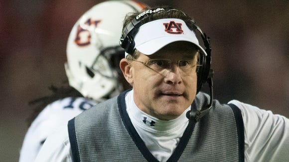 Auburn coach Gus Malzahn argues with a referee during the Iron Bowl at Bryant-Denny Stadium in Tuscaloosa, Ala., on Saturday, Nov. 29, 2014.