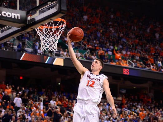 Virginia Cavaliers guard Joe Harris (12) rises up for a fastbreak lay-up in the ACC championship game against the Duke Blue Devils.
