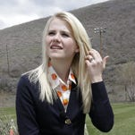 In this file photo, Elizabeth Smart talks with a reporter in Park City, Utah. More than a decade after her kidnapping and rescue grabbed national headlines, Smart is publishing a memoir of her ordeal.