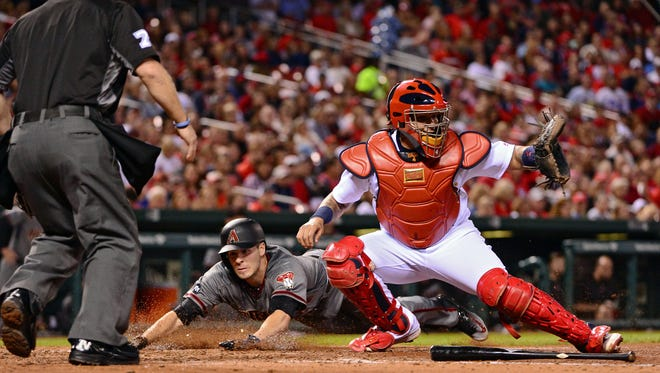 May 20, 2016: Arizona Diamondbacks starting pitcher Patrick Corbin (46) slides head first into home as St. Louis Cardinals catcher Yadier Molina (4) fields the ball during the fifth inning at Busch Stadium.