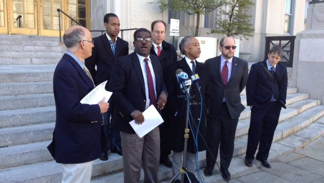 The Rev. Al Sharpton (center) stands amid a group of Westchester officials during a press conference Thursday.