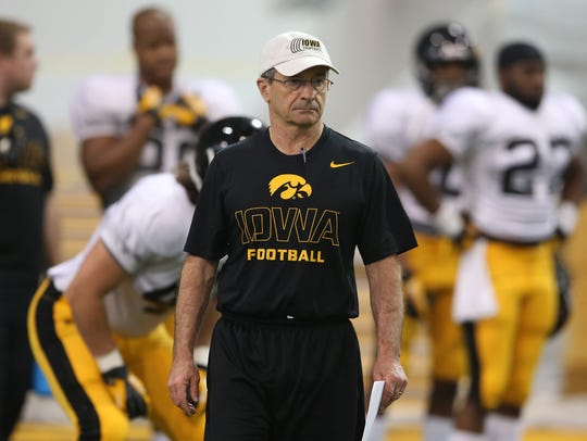 In this 2014 photo, Jim Reid oversees an Iowa football