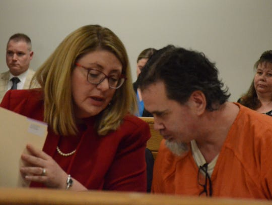 Attorney Tracie Tomak confers with her client, Tony Vandee.