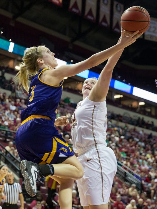 Florida State center Chatrice White, right, blocks the shot of Western Illinois forward Olivia Braun during the first half of a first-round game in the NCAA women's college basketball tournament in Tallahassee, Fla., Friday March 17, 2017. (AP Photo/Mark Wallheiser)