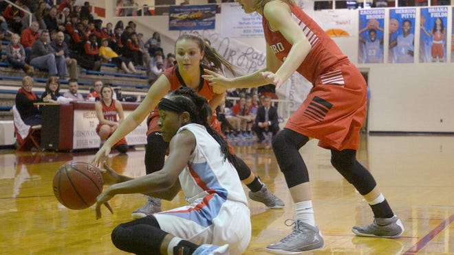 Gibson County's Briana Fields, center, manages to keep her dribble as she is defended by Bradford's Natalie Martin, left, and Anna Taylor on Friday.