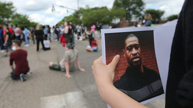 Protesters gather on Exchange Street to rally against police violence and the death of George Floyd on Saturday, May 30, 2020  in Akron, Ohio.