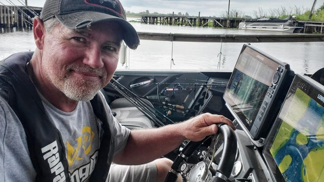 Erie pro bass fisherman Dave Lefebre takes a break from practice in Florida on Friday, June 5, 2020, as severe weather approaches the Kissimmee Chain of lakes. He is scheduled to fish in the Major League Fishing Bass Pro Tour's Heavy Hitters tournament, which opens Sunday.  [CONTRIBUTED PHOTO]\r