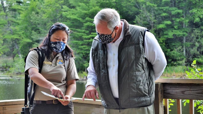 U.S. Secretary of the Interior David Bernhardt gets a briefing on enhancements to the Great Bay National Wildlife Refuge from Nancy Pau, a wildlife biologist with the U.S. Fish and Wildlife Service.