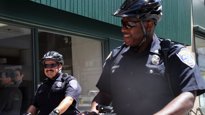 Officers Eliud Rodriguez, left, and Mark McDonald, patrol in front of the downtown police substation in 2013. The city of Rochester has made greater strides in diversifying its police force than the rest of the county.