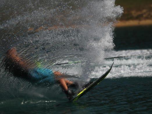Sean Hunter, 17, from Dothan, Ala., water skis on Lake