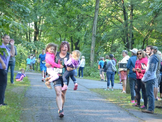 Kalamazoo's Kara Morse carries her children across
