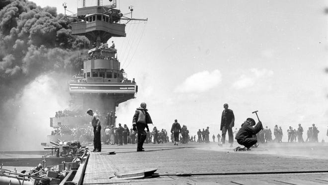 The USS Yorktown after three Japanese bombs struck the ship during the Battle of Midway on June 4, 1942.