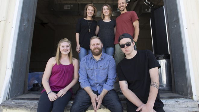 The team of local photography and videography business PHOCO in the company's new warehouse space across the street from the Artery Thursday, May 26, 2016.