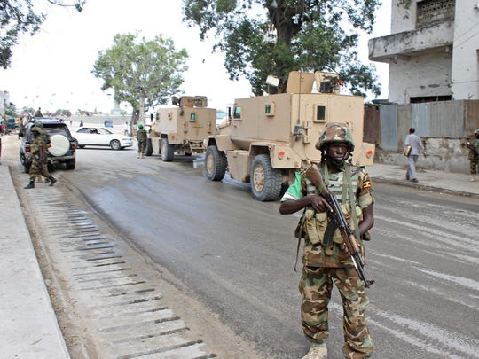 Soldiers of the African Union Mission in Somalia (Amisom) secure an area near the Godka Jillicow prison in Mogadishu on August 31, 2014.