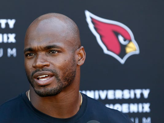 FILE - In this Oct. 11, 2017, file photo, Arizona Cardinals running back Adrian Peterson answers a question during an NFL football news conference at the team's training facility in Tempe, Ariz.  The Cardinals host the Tampa Bay Buccaneers on Sunday. (AP Photo/Ross D. Franklin, File)