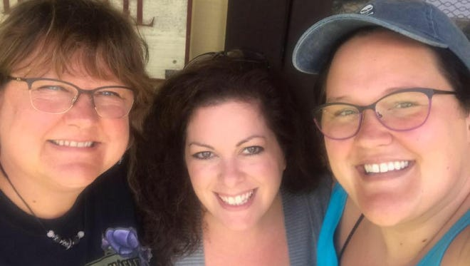 Amy Hessel, center, is flanked by former New Freedom Rail Trail Cafe owners Carol (left) and Danielle Childs. Hessel purchased the business from Carol and Danielle in August.