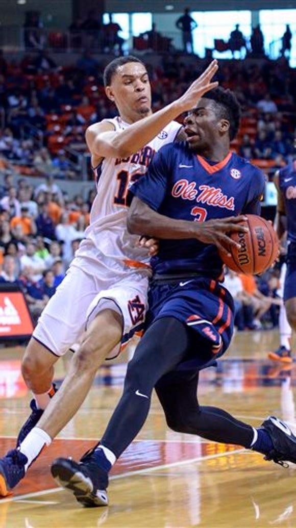 Auburn forward Tyler Harris (12) defends against Mississippi
