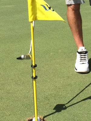 The E-Z Lyft allows golfers to safely remove the golf ball from the hole using a putter to raise the rod attached to a plastic disc inside the hole without reaching into the hole or touching the flagstick.