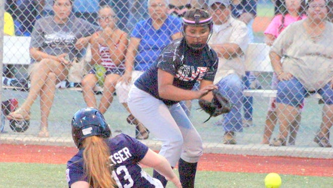 Silver City All-Star pitcher Mireya Arizaga covers home plate against Deming in the 9-11 division.