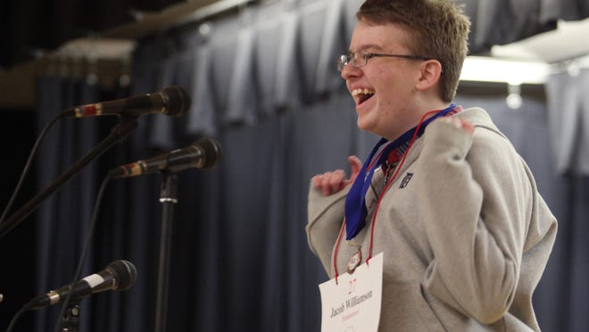 Jacob Williamson, 15, celebrates after spelling his word correctly during the championship round of the Lee County Middle School Spelling Bee in March. Williamson is now in Washington, D.C., for the Scripps National Spelling Bee.