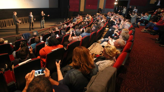 President of Heartland Film Festival, Stuart Lowery, left,  introduces Writer, Director David Dobkin, center, and star Robert Downey Jr., right,  at the premiere of The Judge, Saturday October 4th, during Heartland Film Festival.