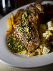 Vermont raised strip steak with chimichurri, roasted cauliflower and fries at the Hatchet Tap and Table in Richmond, $24