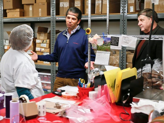 Republican Rick Saccone, right, and Donald Trump Jr., talk with chocolate workers as they take a tour of Sarris Candies during a campaign stop, Monday, March 12, 2018 in Canonsburg, Pa. Saccone is running against Democrat Conor Lamb in a special election being held on March 13 for the PA 18th Congressional District vacated by Republican Tim Murphy. (AP Photo/Keith Srakocic)